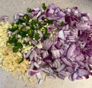 chopped vegetables for chana aloo curry recipe